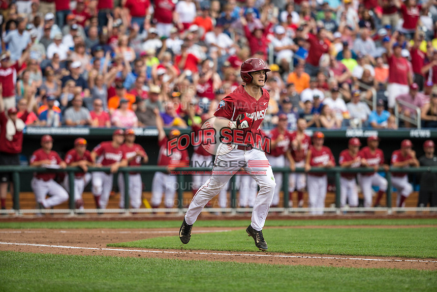 Andrew Benintendi (16) of the Arkansas Razorbacks runs after hitting a home run during a game between the Virginia Cavaliers and Arkansas Razorbacks at TD Ameritrade Park on June 13, 2015 in Omaha, Nebraska. (Brace Hemmelgarn/Four Seam Images)