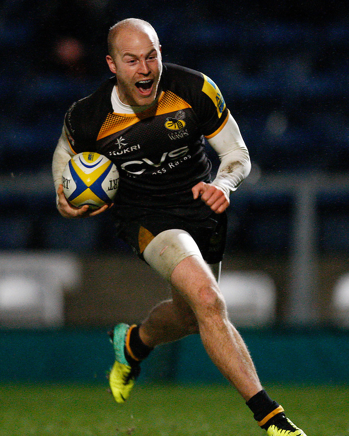 Photo: Richard Lane/Richard Lane Photography. London Wasps v Exeter Chiefs. Aviva Premiership. 05/01/2014. Wasps' Joe Simpson celebrates as he runs in for a try.