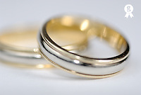 Close up of two wedding rings, in studio (Licence this image exclusively with Getty: http://www.gettyimages.com/detail/74583271 )