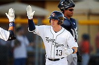 Lakeland Flying Tigers right fielder Mike Gerber (13) high fives a teammate after scoring a run during a game against the Tampa Yankees on April 7, 2016 at Henley Field in Lakeland, Florida.  Tampa defeated Lakeland 9-2.  (Mike Janes/Four Seam Images)