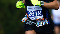 09 SEP 2011 - CHESTER, GBR - Energy gels hang from a competitors race belt during the MBNA Chester Marathon .(PHOTO (C) NIGEL FARROW)