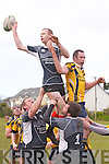 Iveragh Eagles Barry O'Sullivan is lifted high by team mates l-r; Micheal O'Shea & John O'Shea to take this line-out ball in the J2 semi-final against Dolphin RFC at Cracow Park Valentia on Monday last.
