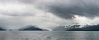Panorama landscape of low lying clouds over the Chugach National Forest in College Fjord, Prince William Sound, Alaska.