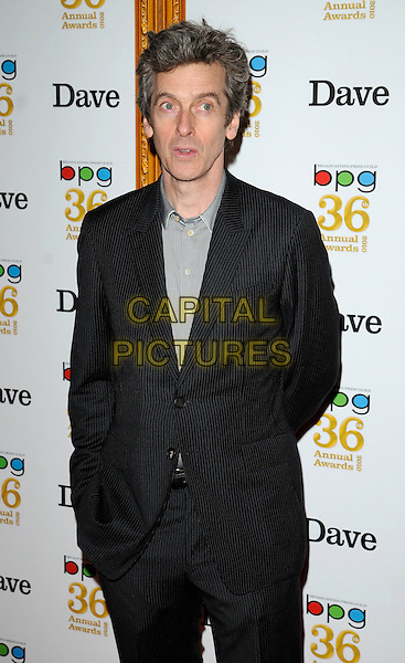 PETER CAPALDI .At the Broadcasting Press Guild (BPG)Television & Radio Awards, Theatre Royal, Drury Lane, London, Engand, Uk, March 26h 2010..Tv arrivals half length grey gray black striped pinstripe suit jacket shirt .CAP/CAN.©Can Nguyen/Capital Pictures