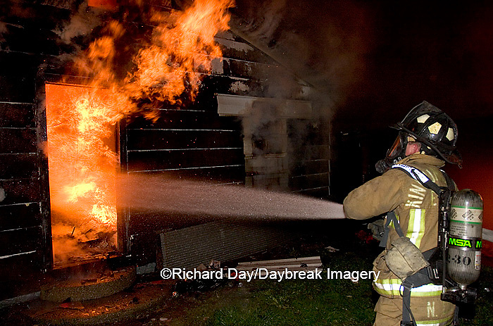 63818-019.03 Firefighter fighting house fire, Kinmundy, IL