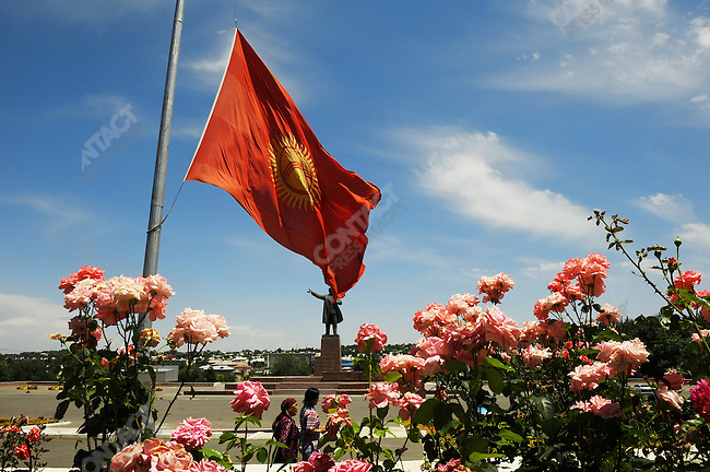 After a week of inter-ethnic violence between Krygyz and Uzbek's the national flag of Kyrgyzstan flew at half mast outside the Osh town hall the as people walked through the still largely vacant city as the statue of Lenin looked on. Osh, Kyrgyzstan, June 19, 2010