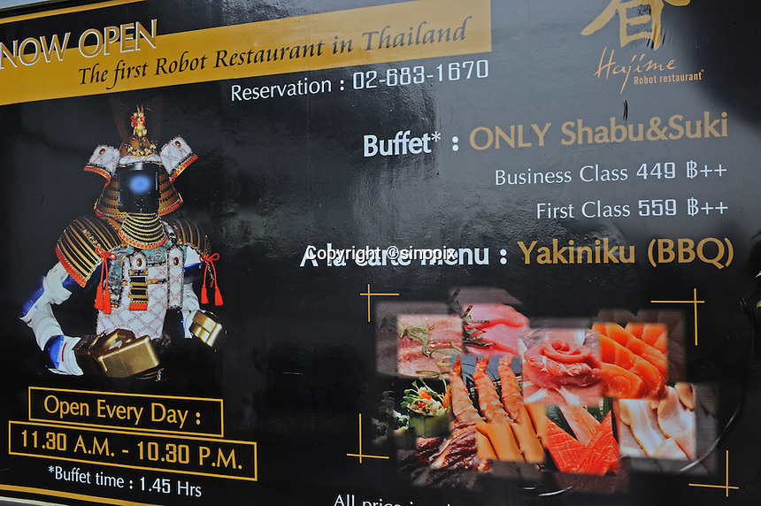 Advertising board of Hajime Restaurant states the price of buttet and menu, Bangkok, Thailand. Hajime is a Japanese restaurant in Thailand, has samurai style robot serving food to the diners and even do a dance session to entertain guests. This robot are made in Japan and costed about 86,600,000 yen (1,063,717USD). Customers order food in the Hajime Restaurant from touch panel and Samurai robot will bring ordered food to their table.<br />15 Oct 2010