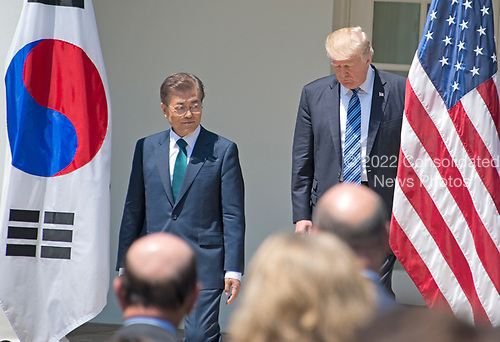 United States President Donald J. Trump and President Moon Jae-in of the Republic of Korea arrive to make joint statements in the Rose Garden of the White House in Washington, DC on Friday, June 30, 2017.  <br /> Credit: Ron Sachs / CNP