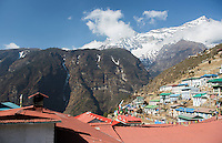 Nepal Namche Bazarre. Prayer Flags over buildings with mountains in the background remote, Mt Everest