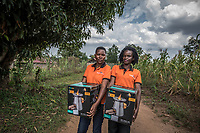 Uganda, Mmanze. Brightlife sales reps with products.