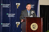 4 May 2012:  FIU Assistant Athletic Director for Media Relations Paul Dodson speaks at a press conference during which the FIU Golden Panthers, currently a member of the Sun Belt Conference, formally announced their acceptance of an invitation to join Conference USA for all sports starting July 1, 2013, at the FIU Stadium Club in Miami, Florida.