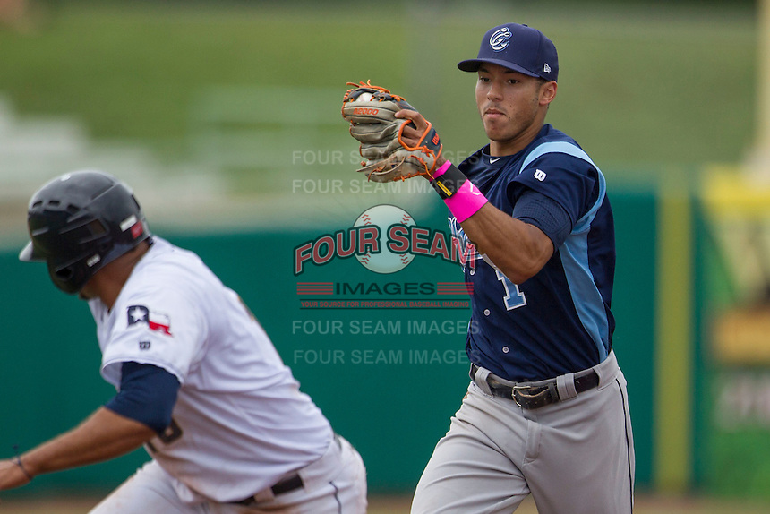 Corpus Christi Hooks shortstop Carlos Correa (1) prepares to tag San Antonio Missions baserunner Diego Goris (15) during a rundown in the Texas League baseball game against the on May 10, 2015 at Nelson Wolff Stadium in San Antonio, Texas. The Missions defeated the Hooks 6-5. (Andrew Woolley/Four Seam Images)