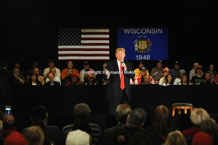 Republican presidential frontrunner Donald Trump speaks at the Radisson Paper Valley Hotel in Appleton, Wisconsin on March 30, 2016.  After introducing the topic of Syrian refugees and ISIS, Trump read an incendiary poem about a snake that attacks a woman that tried to give it refuge in a clear parable of his views on providing sanctuary to those individuals fleeing the Syrian civil war.