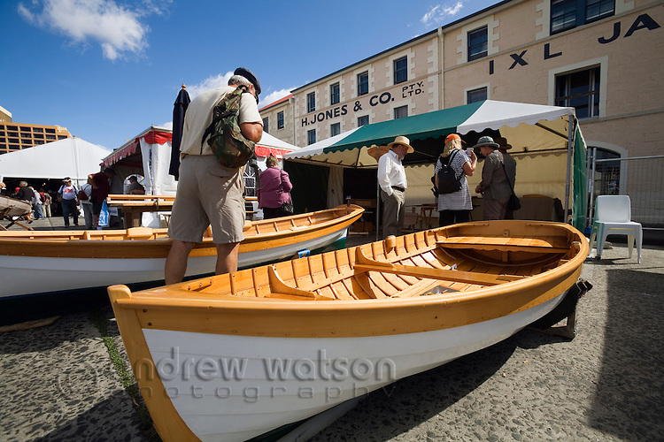 Visitors inspect handmade boats at the Wooden Boat Festival.  The bi-annual festival is the largest congregation of wooden craft in the southern hemisphere.  Hobart, Tasmania, AUSTRALIA