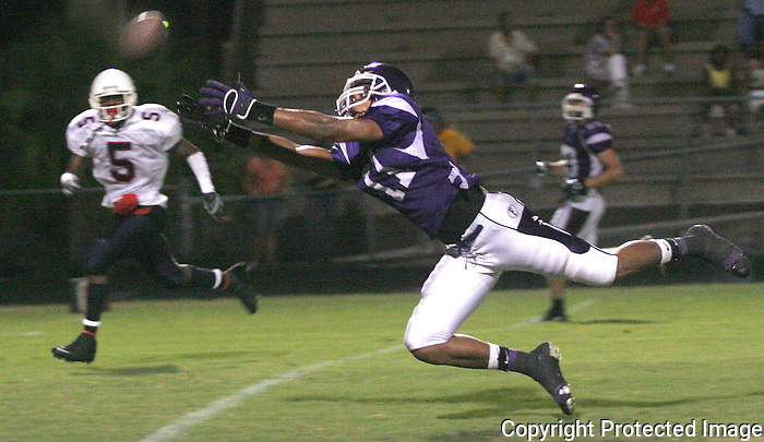 Gary Wilcox / StaffÉ08/26/07É. Fletcher High Varsity football player Lamar Scruggs (#11) tries to make a catch during the first half of the Wolfson High School at Fletcher Kickoff Classic Football game at Fletcher High School last Friday Night. (08/24/07). Wolfson High won 13 to 0.