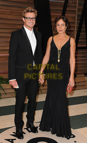 WEST HOLLYWOOD, CA - MARCH 2: Simon Baker, Rebecca Rigg arrives at the 2014 Vanity Fair Oscar Party in West Hollywood, California on March 2, 2014. <br /> CAP/MPI/MPI213<br /> &copy;MPI213 / MediaPunch/Capital Pictures