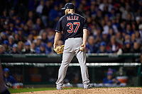Cleveland Indians pitcher Cody Allen (37) looks in for the sign in the seventh inning during Game 5 of the Major League Baseball World Series against the Chicago Cubs on October 30, 2016 at Wrigley Field in Chicago, Illinois.  (Mike Janes/Four Seam Images)