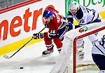 10 April 2010: Montreal Canadiens' center Tomas Plekanec makes a wrap-around play during the last game of the regular season against the Toronto Maple Leafs at the Bell Centre in Montreal, Quebec, Canada. The Leafs defeated the Habs 4-3 in sudden death overtime, as the Canadiens advance to the Stanley Cup Playoffs with the single point. Mandatory Credit: Ed Wolfstein Photo