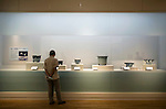 A visitor looks at Seto plant pots on display at the Saitama Omiya Bonsai Museum of Art in Saitama, Japan on 15 Aug. 2011..Photographer: Robert Gilhooly