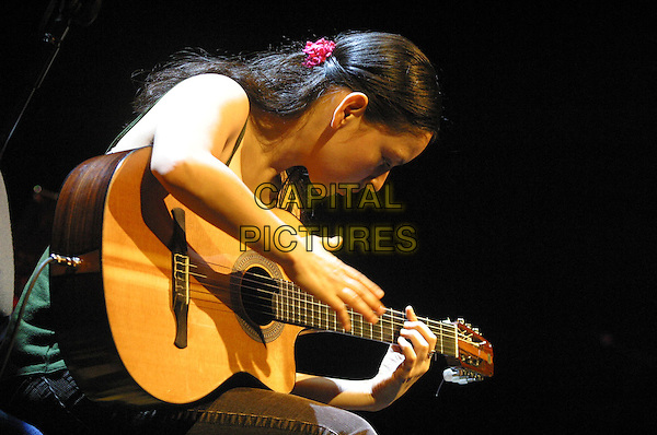 GABRIELA.Rodrigo & Gabriela Live at Nottingham Arena, Nottingham..UK, United Kingdom..10th December 2005.Ref: JEZ.half length playing acoustic guitar guitarist performing live onstage on stage music gig concert show .www.capitalpictures.com.sales@capitalpictures.com.©Capital Pictures