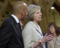 18 May 2016 - London England - Home Secretary Theresa May and Chuka Umunna walk through the Central lobby of the House of Commons during the State Opening of Parliament, Palace of Westminster, London. The State Opening of Parliament marks the formal start of the parliamentary year and the Queen's Speech sets out the government's agenda for the coming session. Photo Credit: ALPR/AdMedia