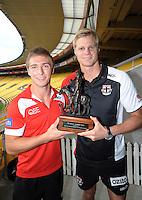 Sydeney Swans captain Kieren Jack (left) and Saints captain Nick Riewoldt with the Simpson-Henderson Trophy during the St Kilda Saints v Sydney Swans press conference at the Aotea Lounge, Westpac Stadium, Wellington, New Zealand on Wednesday, 24 May 2013. Photo: Dave Lintott / lintottphoto.co.nz