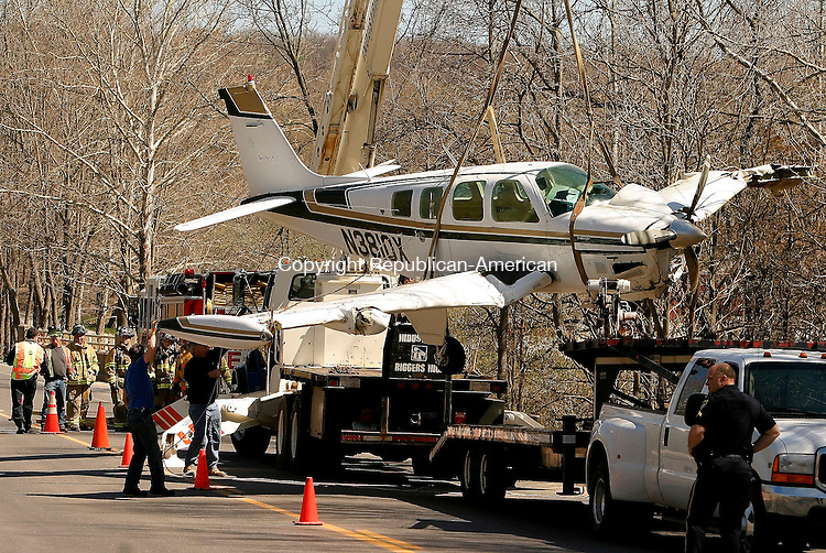 SOUTHBURY, CT - 21 APRIL 2005 - 042105JS01--Workers from Industrial Riggers of Waterbury on Thursday, removing the wreckage of the single-engine plane that crashed in Southbury on Wednesday afternoon. The plane was loaded onto a trailer and taken from the scene. <br /> --Jim Shannon Photo --Southbury; Industrial Riggers are CQ