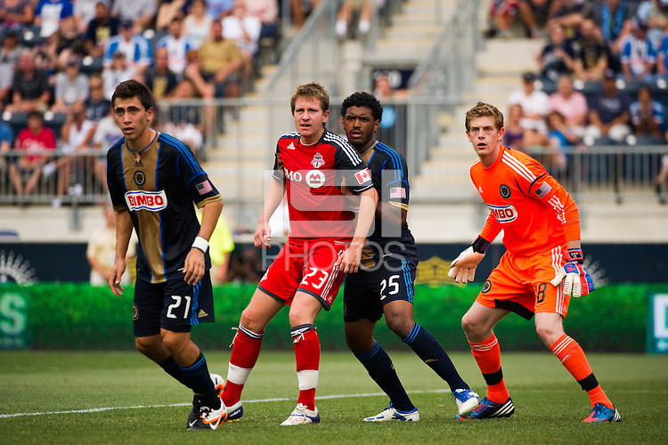 Terry Dunfield (23) of Toronto FC and Sheanon Williams (25) of the Philadelphia Union look to get position on a corner kick. The Philadelphia Union defeated Toronto FC 3-0 during a Major League Soccer (MLS) match at PPL Park in Chester, PA, on July 8, 2012.