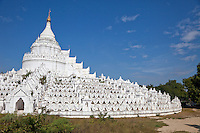 Myanmar, Burma.  Mingun, near Mandalay.  Hsinbyume Paya Stupa, completed 1816.  Seven wavy terraces around the stupa represent the seven mountain ranges around Mt. Meru, center of the universe in Hindu and Buddhist cosmology.