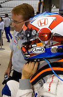 Pole Weekend for the 87th Indianapolis 500, Indianapolis Motor Speedway, Speedway, Indiana, USA  25 May,2003.Roger Yasukawa unstraps his helmet following practice..World Copyright©F.Peirce Williams 2003 .ref: Digital Image Only..F. Peirce Williams .photography.P.O.Box 455 Eaton, OH 45320.p: 317.358.7326  e: fpwp@mac.com..