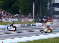 May 31, 2014; Englishtown, NJ, USA; NHRA top fuel driver Richie Crampton (right) races alongside teammate Morgan Lucas during qualifying for the Summernationals at Raceway Park. Mandatory Credit: Mark J. Rebilas-USA