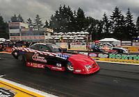 Aug. 5, 2011; Kent, WA, USA; NHRA funny car driver Gary Densham (near lane) races alongside Matt Hagan during qualifying for the Northwest Nationals at Pacific Raceways. Mandatory Credit: Mark J. Rebilas-
