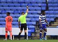 7th July 2020; Madejski Stadium, Reading, Berkshire, England; English Championship Football, Reading versus Huddersfield; Yakou Meite of Reading receives a yellow card for a foul on Karlan Grant of Huddersfield