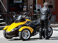 "BRP Can-Am Spyder Roadster is seen on Avenue Cartier in Quebec City May 4, 2009. The Can-Am Spyder Roadster (""Spyder""), a three-wheeled motorcycle (two wheels in the front, one in the rear), is manufactured by Bombardier Recreational Products, Inc. (BRP), a privately held industry-leading powersports manufacturer headquartered in Valcourt, Québec, Canada."