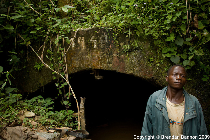 Portrait of Congolese miner at Makala Mine. The  colonial era mine was abandoned and is now exploited by independent miners who chisel out rocks from the walls of many of the tunnels. many walk and work in waist deep waters for as long as 24 hours before emerging with  the stones that they hope will have gold in them.