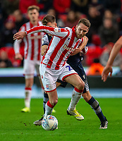 11th January 2020; Bet365 Stadium, Stoke, Staffordshire, England; English Championship Football, Stoke City versus Milwall FC; Nick Powell of Stoke City is tackled - Strictly Editorial Use Only. No use with unauthorized audio, video, data, fixture lists, club/league logos or 'live' services. Online in-match use limited to 120 images, no video emulation. No use in betting, games or single club/league/player publications