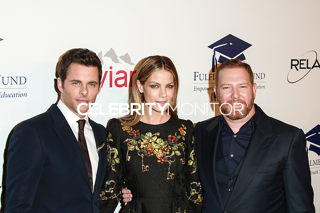 BEVERLY HILLS, CA, USA - OCTOBER 14: James Marsden, Michelle Monaghan, Ryan Kavanaugh arrive at the 20th Annual Fulfillment Fund Stars Benefit Gala held at The Beverly Hilton Hotel on October 14, 2014 in Beverly Hills, California, United States. (Photo by David Acosta/Celebrity Monitor)