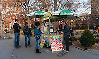 "New York, NY - 30 November 2013 One of two Hot Dog vendors in Washington Square Park. The vendors contracts to operate in the par is expected not to be renewed after the new Washington Square Park Conservancy deemed them ""unsightly."""