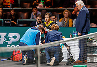 Rotterdam, The Netherlands, 9 Februari 2020, ABNAMRO World Tennis Tournament, Ahoy,  Vasek Pospisil (CAN) is treated for a knie injury<br /> Photo: www.tennisimages.com