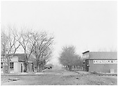View of Espanola main street and Santa Fe Branch track.  The Espanola Mercantile store is prominent.<br /> D&amp;RG  Espanola, NM  circa 1916
