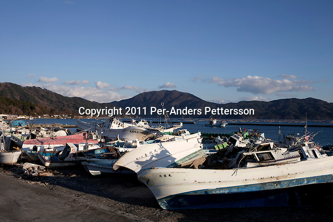 OTSHUSHI, JAPAN - DECEMBER 5: An cemetery of destroyed fishing boats on December 5, 2011, in Otshushi, Japan. The small town was almost wiped off the map during the tsunami and only a supermarket and Buddhist temple remain standing in the center of the town. Northeastern Japan's coastline was struck by an earthquake measuring 9.0 on the Richter scale and a Tsunami on March 11, 2011 which destroyed villages and livelihoods for hundreds of thousands of people. Almost 16,000 dead, thousands missing, more than 700,000 properties destroyed and an estimated 387,000 survivors lost their homes. Its estimated that it will take more than five years to rebuild. The cost is estimated to 309 billion U.S. dollars, the world's most expensive natural disaster. Many children suffered especially with school destroyed, education interrupted and the loss of family members took a heavy toll. (Photo by Per-Anders Pettersson)