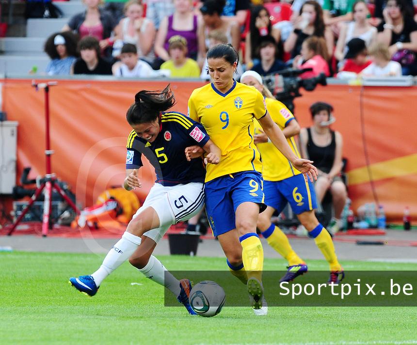 Fifa Women's World Cup Germany 2011 : Colombia - Sweden at Bayarena Leverkusen : Jessica Landstrom in duel met Nataly Arias.foto DAVID CATRY / Vrouwenteam.be