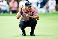 March 29, 2009, Arnold Palmer Invitation.   Tiger Woods lines up a putt on the 2nd green during final round play  at Bay Hill Golf Club in Orlando, Florida...