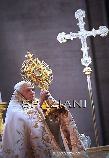 Pope Benedict XVI salutes the faithful during the prayer vigil with priests in St. Peters' square on June 10, 2010 at the Vatican during the final day of the Vatican's Year for Priests