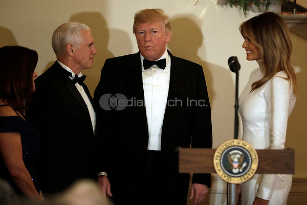 United States President Donald J. Trump with First Lady Melania Trump (R), US Vice President Mike Pence and his wife Karen Pence attend the Congressional Ball at White House in Washington on December 15, 2018. <br /> Credit: Yuri Gripas / Pool via CNP / MediaPunch
