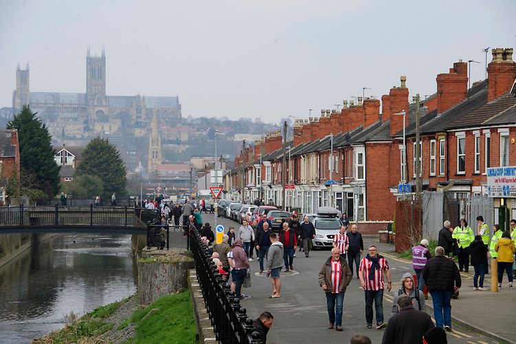 Lincoln City fans arrive at the ground prior to the game<br /> <br /> Photographer Chris Vaughan/CameraSport<br /> <br /> The EFL Sky Bet League Two - Lincoln City v Macclesfield Town - Saturday 30th March 2019 - Sincil Bank - Lincoln<br /> <br /> World Copyright © 2019 CameraSport. All rights reserved. 43 Linden Ave. Countesthorpe. Leicester. England. LE8 5PG - Tel: +44 (0) 116 277 4147 - admin@camerasport.com - www.camerasport.com