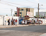 BELIZE. Belize City, a bus stop scene in the center of town