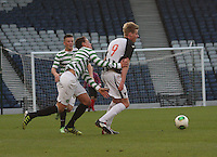 Jackson Irvine pulls back Blair Henderson in the Dunfermline Athletic v Celtic Scottish Football Association Youth Cup Final match played at Hampden Park, Glasgow on 1.5.13.