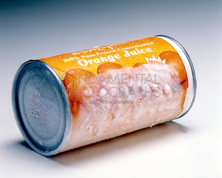 FROST AND CONDENSATION -Orange Juice Container<br /> As Warm Air Melts Frost  Water Droplets Form.
