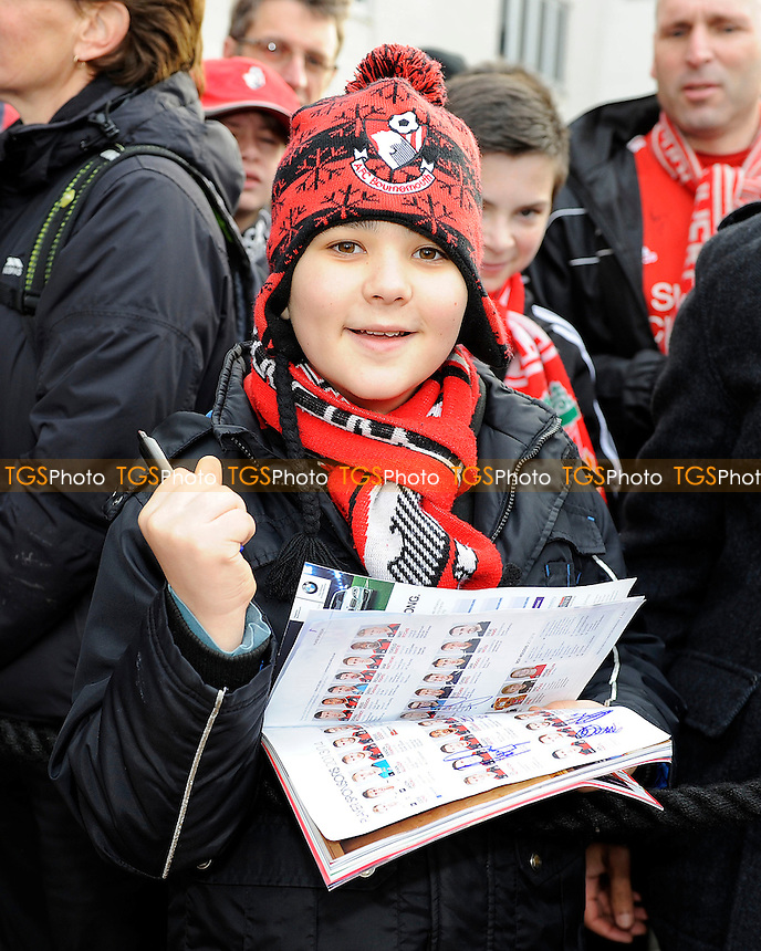 A young AFC Bournemouth fan waits for an autograph - AFC Bournemouth vs Liverpool - FA Cup 4th Round Football at the Goldsands Stadium, Bournemouth, Dorset - 25/01/14 - MANDATORY CREDIT: Denis Murphy/TGSPHOTO - Self billing applies where appropriate - 0845 094 6026 - contact@tgsphoto.co.uk - NO UNPAID USE